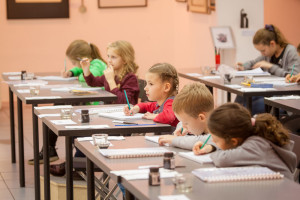 Kids studying pointed pen