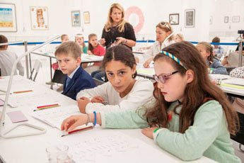 Children get exposed to the great art of calligraphy from young age