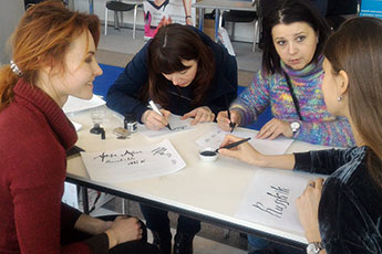 Calligraphy lessons at the Euro Shoes Premiere Collection Exhibition