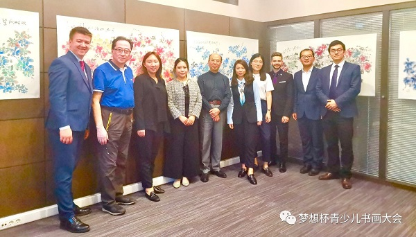 """A joint photo of Mr Hua Kui and the employees of the Moscow office of DHH legal group taken on May 27th  to remember the opening ceremony of the exhibit """"Happy flowers, flowers of Hua Kui"""""""